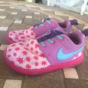 girls NIKEs size 10